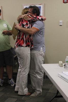 Westhampton Beach Trustees Hank Tucker and Patricia DiBenedetto hug in celebration after hearing that they were reelected on Friday. BY CAROL MORAN