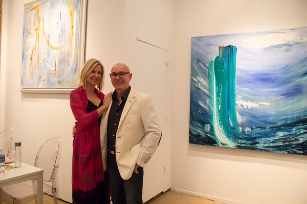 Lea Fisher and J.D. Miller in front of each of their work at the Samuel Lynne Galleries booth. MAGGY KILROY