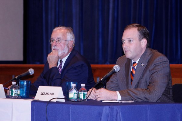 Congressman Tim Bishop, left, and State Senator Lee Zeldin during a debate at Westhampton Beach High School. KYLE CAMPBELL