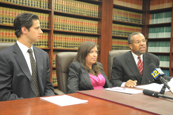 Attorney G. William Germano Jr., plaintiff Nancy Genovese and Attorney Frederick K. Brewington speak at a press conference, Thursday, July 29 in Hempstead.