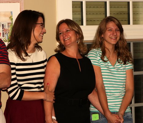June 26 -- Westhampton Beach Mayor-elect Maria Moore, center, smiles after learning that she had defeated Conrad Teller in the election. She is joined by her daughters, Elizabeth and Jackie.