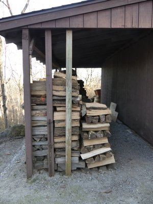 For long-term storage of firewood, a woodshed can't be beat. This wood will last for years if it's kept dry. You can find woodshed designs online or buy small ones prefabricated. ANDREW MESSINGER