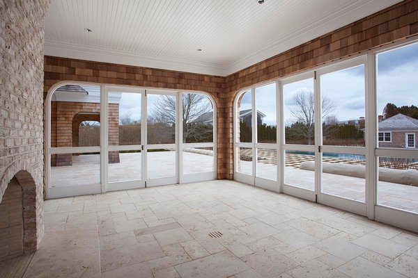 Porches, like this one by builder Jeffrey Colle, should be winterized by removing screens and replacing glass with storm windows. COURTESY MIDDLETON & GENDRON