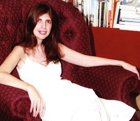 Lucette Lagnado reclines in her favorite chair at Canio's Books in sag Harbor.