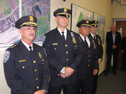The Southampton Town Police Department's top brass: Chief Robert Pearce, foreground, newly promoted Captain Lawrence Schurek, Lieutenant James Kiernan and Lieutenant Michael Zarro were present for Capt. Schurek's swearing in on Tuesday. M. Wright