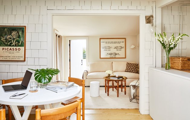 A mix of generally darker, more saturated wood tones add character to a historic Sag Harbor cottage-each wooden note framed by a neutral base. CHRISTIAN HARDER