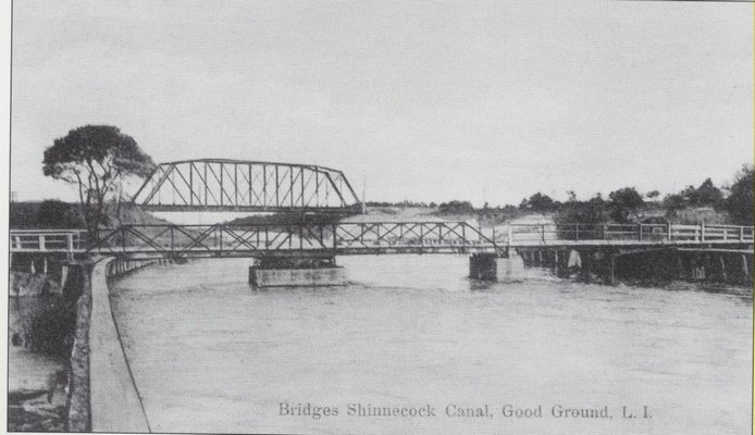 Bridges over the Shinnecock Canal accelerated the development of what in this image was still a sparsely populated hamlet. An 1899 railroad bridge can be seen in the background and an 1892 one-lane swing bridge for wagons and automobiles  in the foreground. HAMPTON BAYS HISTORICAL SOCIETY