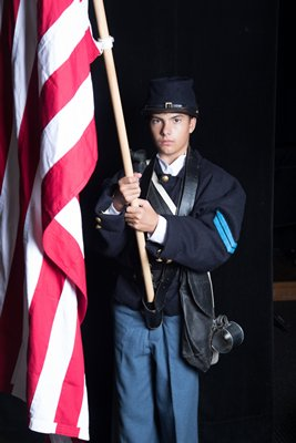 Ethan Suhr as Billy the Flagbearer. MARY GODFREY