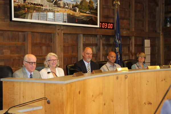 The East Hampton Town Board is split over its support for the Deepwater Wind power cable application, with Councilmen Jeff Bragman, far left, and David Lys, second from right, saying they will vote against it.