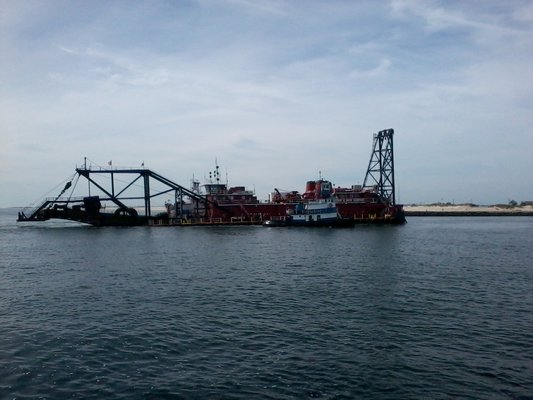 """The dredging vessel """"Illinois"""" arrived in Shinnecock Bay last week but has been kept at anchor by high seas, which have pushed the start date for the beach reconstruction project back again from Thursday until early next week. T. Richter"""