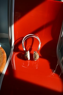 "A pair of art headphones that rest on a chair in a guest area. ""You can wear them when you read,"" Joan Hornig explains. CHRIS ARNOLD"