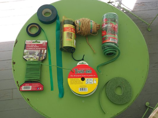 There are plenty of options for tying plants to stakes from flexible ribbons (top left), to natural twine (top center), foam covered wire (top right), Velcro strips (bottom right) and the good old paper covered wire Twist-Ems (center bottom). There's a tie for every type of connection. ANDREW MESSINGER