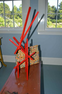 A Vaiasuso sculpture maquette juxtaposed with a a $6 South African artisinal handbag made from gum wrappers. CHRIS ARNOLD