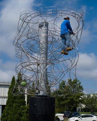 "Robert Mojeski sets his new sculpture, ""Synopsis,"" in motion. VIRGINIA GARRISON"