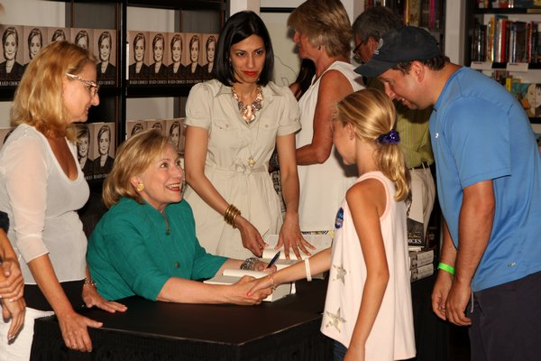 """Hillary Rodham Clinton signs copies of her book """"Hard Choices,"""" at Books & Books on Main Street in Westhampton Beach last summer.  PRESS FILE"""