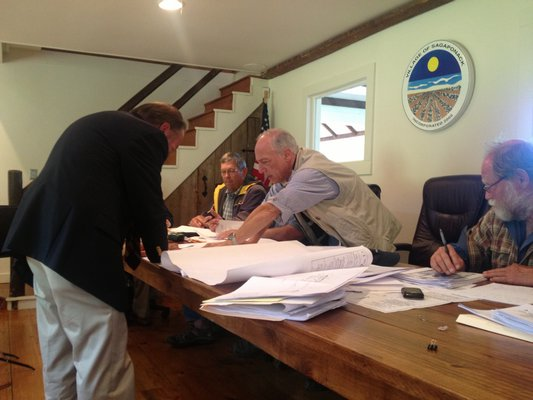 Ira Rennert's Attorney Gil Flanagan and zoning board Chairman Elliot Meisel go over the sketches of Mr. Rennert's property. M. Wright