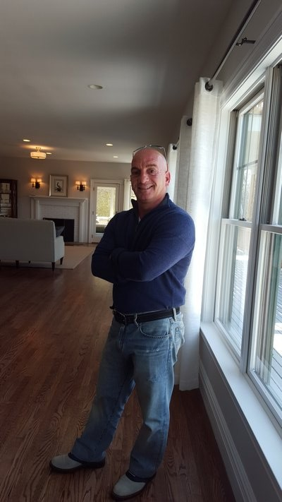 Lawrence Citarelli welcomes guests at his open house in Westhampton. BRIDGET LEROY