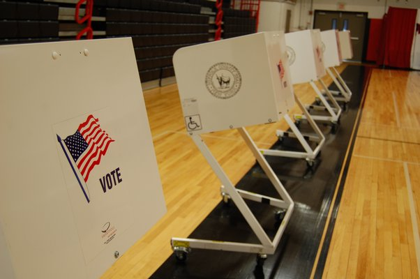 The voting booths set up at the Pierson Middle/High School for residents to vote on funds for the proposed turf field at the school on December 14. JON WINKLER