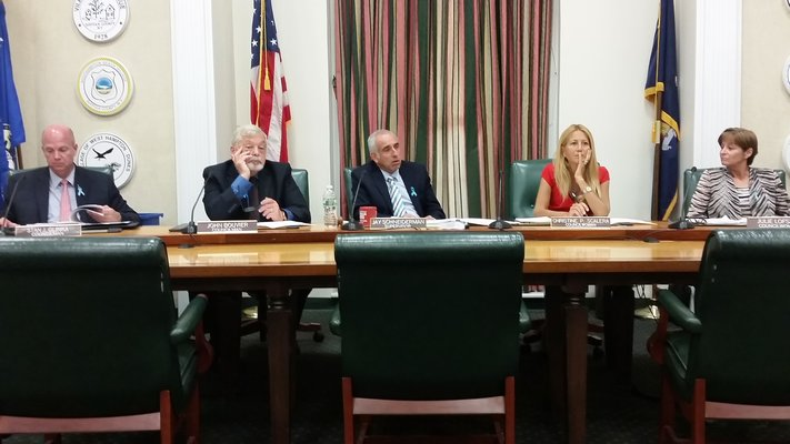 Southampton Town Board listens to Laura Smith, president of the Civil Service Employees Association, regarding the settlement between the union and town.   JEN NEWMAN