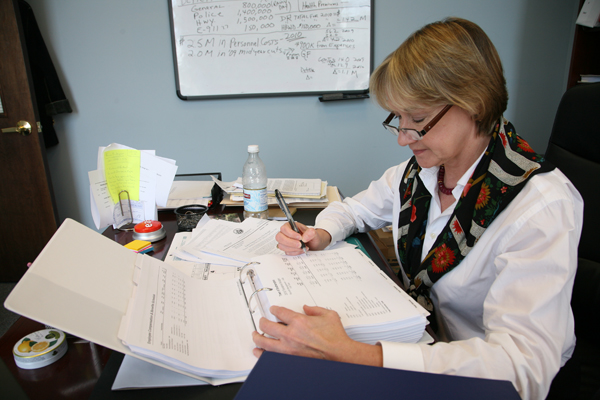 Town Comptroller Tamara Wright was busy reviewing the proposed 2010 budget on Monday.<br></noscript>Photos by Bryan Finlayson