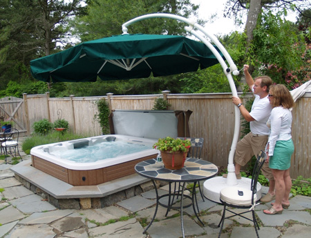 Linda Schoeck and Stanley Schorr show off their personal hot tub at their Westhampton Beach home, which has a shady umbrella.  JENNETT MERIDEN RUSSELL PHOTOS