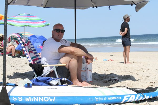 Aaron Warkov was one of two beachgoers who paddled out to the whale and cut some of the net away while they awaited marine scientists to arrive.   MICHAEL WRIGHT