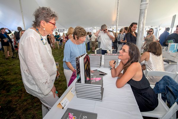 Aithor Bridget Moynahan chats with Ruth Maisel and Renee Hirsch during the East Hampton Library's 15th Annual Authors Night Benefit under the tent at 555 Montauk Highway in Amagansett on Saturday.