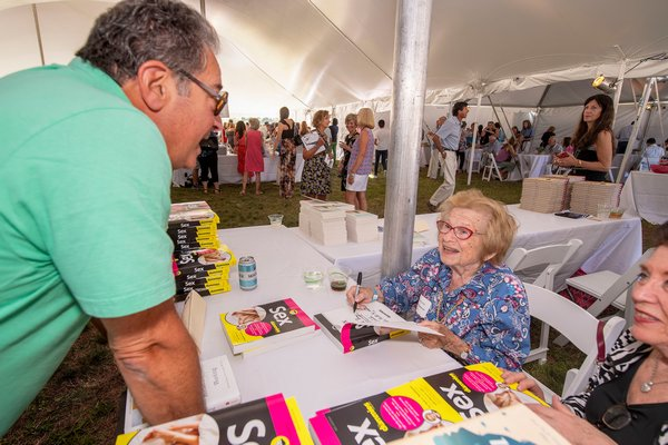 Dr. Ruth Westheimer signs a copy of her book Sex for Dummies for Len Benowich during the East Hampton Library's 15th Annual Authors Night Benefit under the tent at 555 Montauk Highway in Amagansett on Saturday.