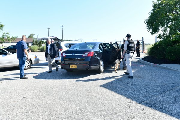 Security was tight at Gabreski Airport on Friday morning prior to President Donald Trump's arrival in the Hamptons. DANA SHAW
