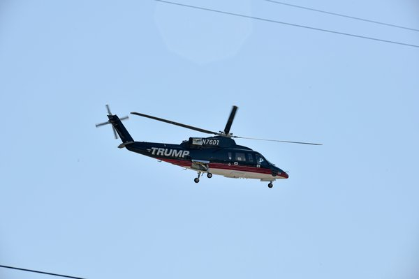 A Trump helicopter lands at Gabreski Airport on Friday morning.         DANA SHAW