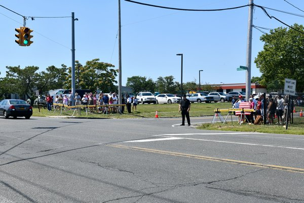 Onlookers on County Road 31 wait for the motorcade to pass.  DANA SHAW
