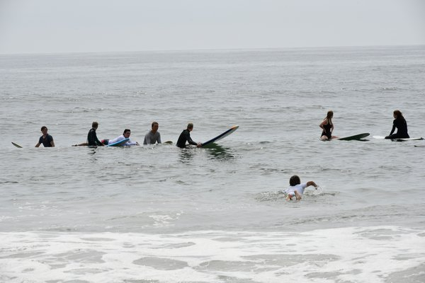 Surfers at Agawam Beach in Southampton Village on Sunday.   DANA SHAW