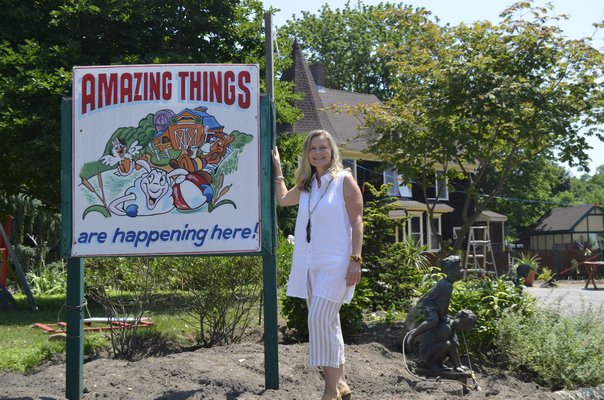 Andrea Libutti at the Center Moriches property where her new school will be opening. ANISAH ABDULLAH
