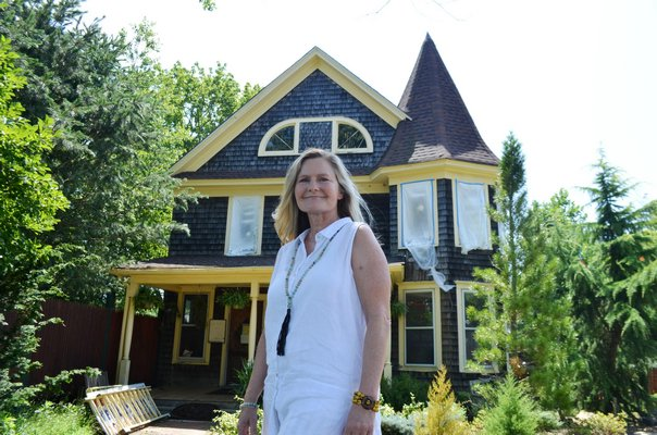 Andrea Libutti at the Center Moriches property where her new private school will be opening. The main building is undergoing renovations during the summer. ANISAH ABDULLAH