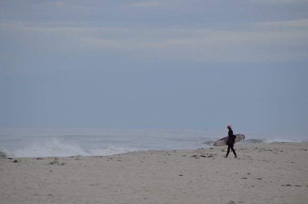 A surfer at Lashley Beach in Westhampton Beach, known as Jetty 4. ANISAH ABDULLAH