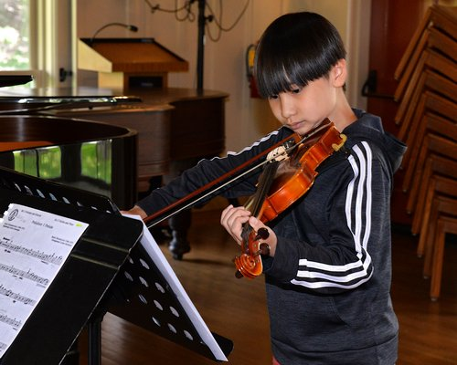 "Nam ""Alex"" Nguyen playing his violin.  KYRIL BROMLEY"