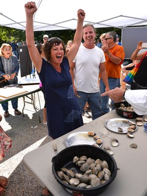 Meredith O'Leary and Jack Dougherty went tooth and nail in the Clam-shucking contest. KYRIL BROMLEY