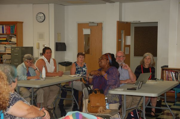 Sag Harbor residents listening to Dr. Oliver Robinson, the superintendent of Shenendehowa Central School District in Albany and New York State superintendent of the year, speaker on Friday.  ELIZABETH VESPE