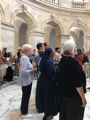 Sister Mary Beth Moore, standing in the back, in the rotunda of the Russell Senate Office Building on July 18. COURTESY SISTER MARY BETH MOORE