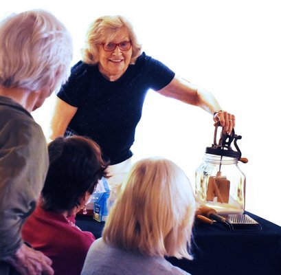 Rev. Karen Campbell giving a presentation on cooking.