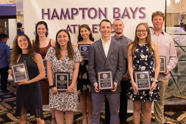 Hampton Bays senior athletes were presented with scholarships during the Hampton Bays Booster Club's annual athletic awards dinner June 5. They included, top row, from left: Rachel Reycroft, Christina Coulton, Kevin McNamara and Sean Noonan; bottom row, from left: Ava Bianchi, Sarah Fassino, Gavin Grismer and Maryrose O'Connell.