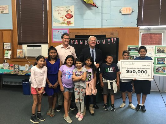 Assemblyman Fred W. Thiele Jr. presented Springs School with a $50,000 check on Monday.   ELIZABETH VESPE
