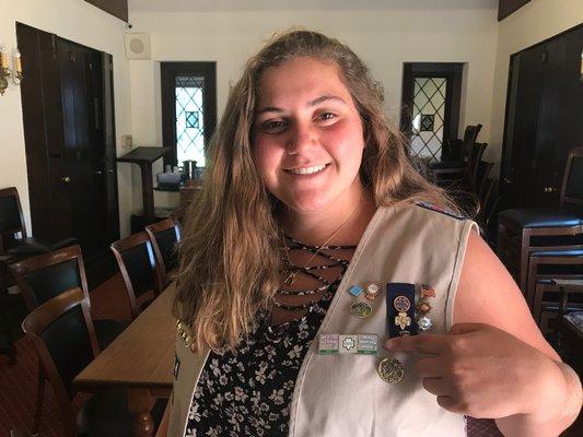 Lucia Ibrahim showing off her badges.  ELIZABETH VESPE