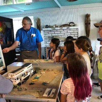 Chris Kohan teaching students at the Art Barge.  COURTESY CHRIS KOHAN