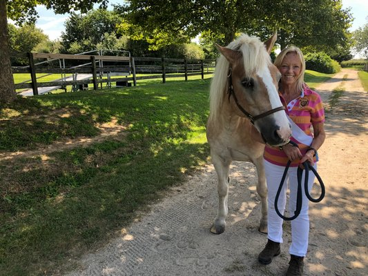 Karen Bocksel, CTREE's managing director/instructor, with Moseley, one of the horses in the program, at Wolffer Estate Stables.