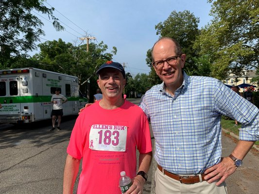 Democratic congressional hopeful Perry Gershon, left, with Stony Brook Southampton Hospital Chief Administrative Officer Robert Chaloner near the finish line on Sunday.
