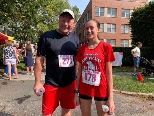 Pierson cross country coach Jim Kinnier with his star runner, Penelope Greene, on Sunday.