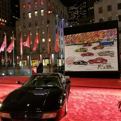 Mitchell Schorr's work on view at a Ferrari exhibtion at Rockefeller Center in New York City.