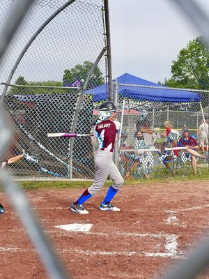 East Hampton's Sienna Salamy follows through on a swing.