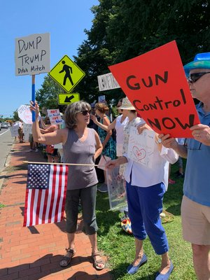 Protesters on the Water Mill Village Green on Friday during President Donald Trump's visit to the Hamptons.  KIM COVELL
